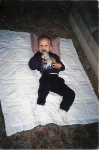 Jordi - on blanket on floor with bottle of milk
